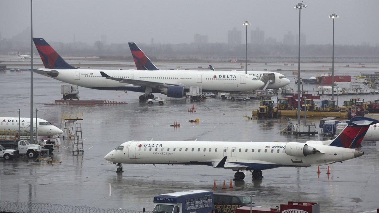 Delta airplanes are grounded, Friday, March 2, 2018, in New York. Airlines have cancelled many flights out of New York as a severe storm arrives in the northeast.