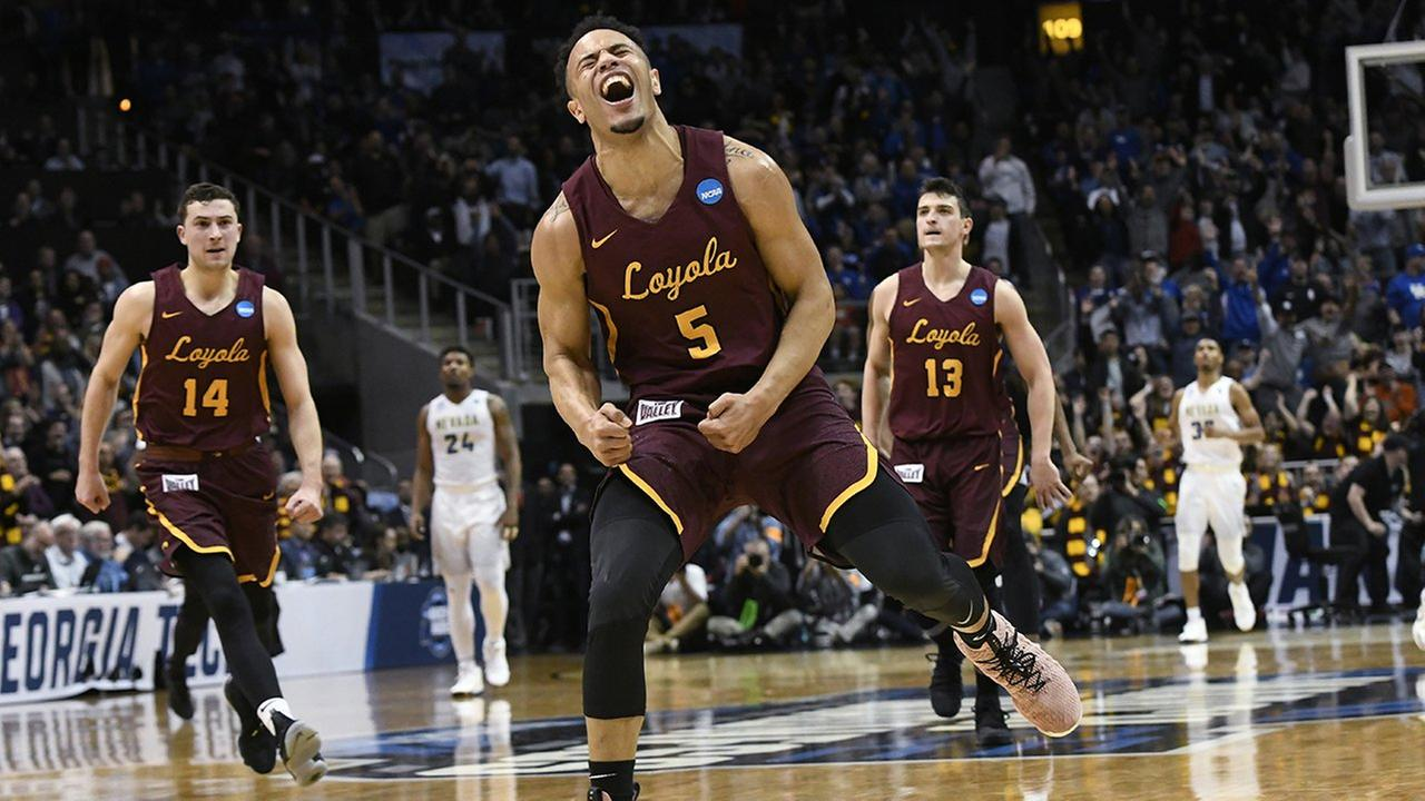 Loyola-Chicago guard Marques Townes (5) celebrates his three-point shot late in the game against Nevada during regional semifinal NCAA college basketball game on Thursday.