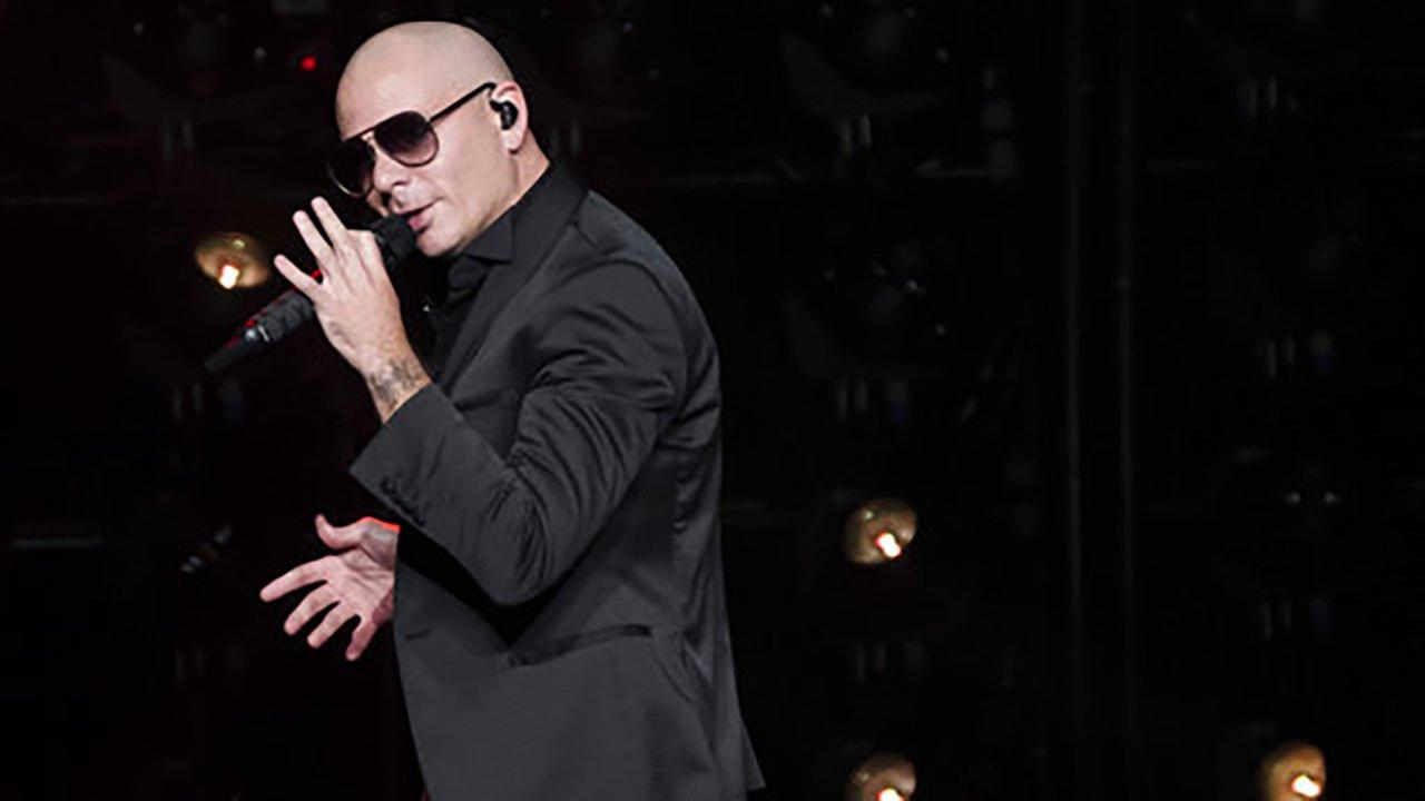 In this June 30, 2017, file photo, Pitbull performs in concert at Madison Square Garden in New York.