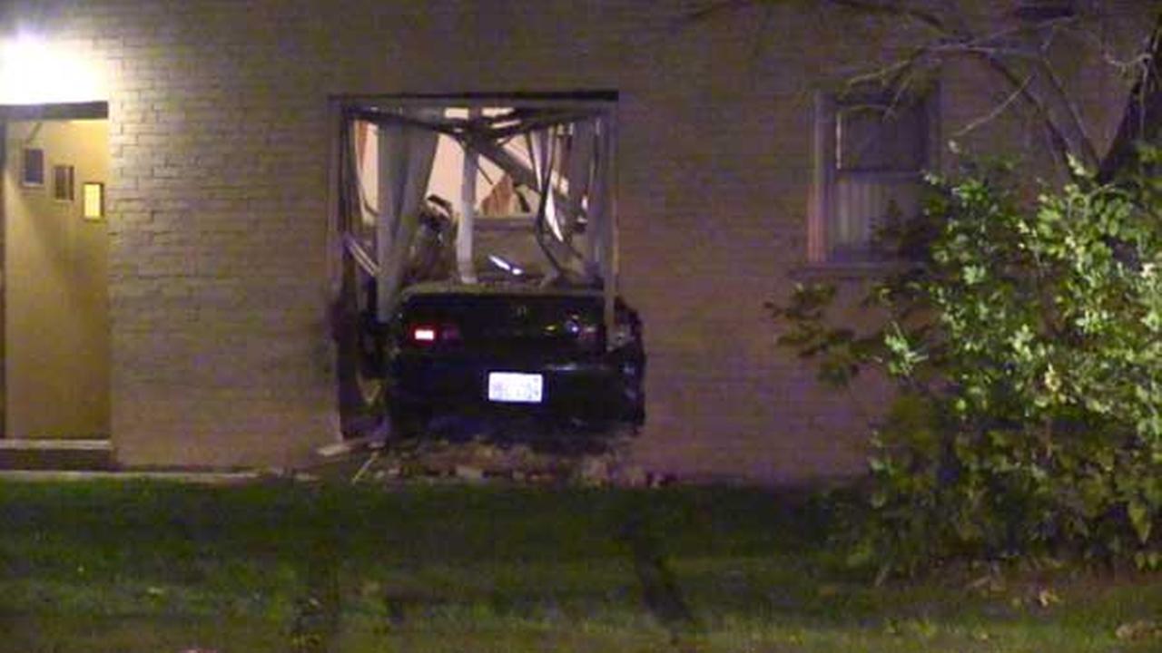 A car slammed into an apartment building in west suburban River Grove.