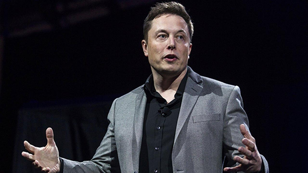 FILE - In this April 30, 2015, file photo, Tesla Motors CEO Elon Musk unveils the companys newest products, in Hawthorne, Calif.