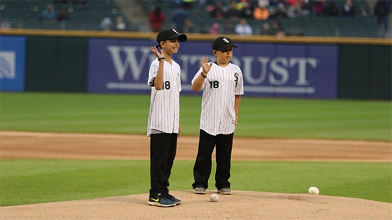 Fallen CFD diver Juan Bucio's sons deliver game ball at White Sox game