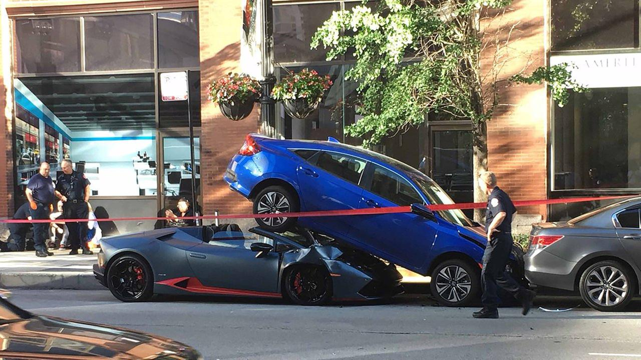 A Lamborghini got wedged beneath another car in a West Loop crash. No one was inside the other car at the time. No one was injured.