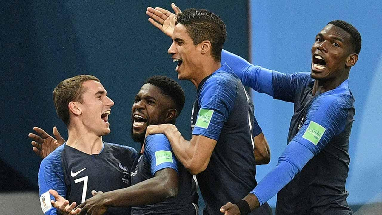 Frances Samuel Umtiti, second from left, is congratulated by his teammates after scoring the opening goal during the semifinal match between France and Belgium.