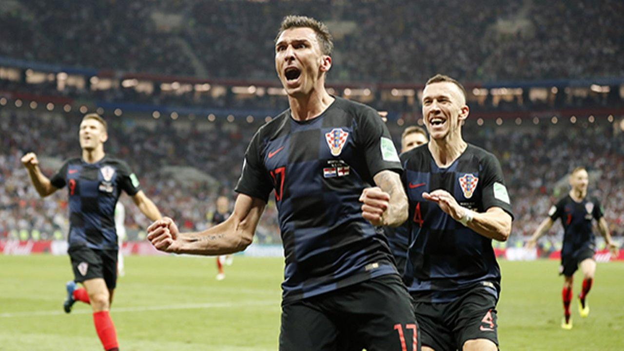 Croatias Mario Mandzukic celebrates after scoring his sides second goal during the semifinal match between Croatia and England at the 2018 soccer World Cup.