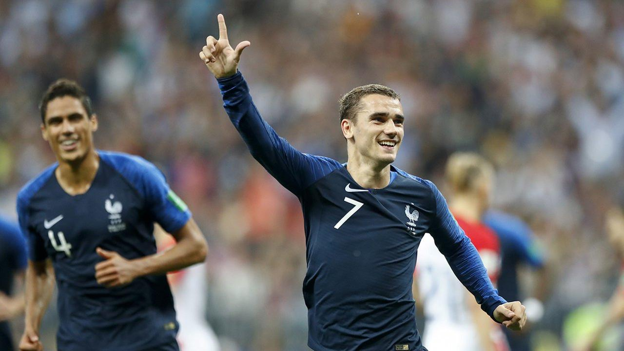 Frances Antoine Griezmann celebrates after scoring on a penalty his side second goal during the final match between France and Croatia at the 2018 soccer World Cup in Moscow.