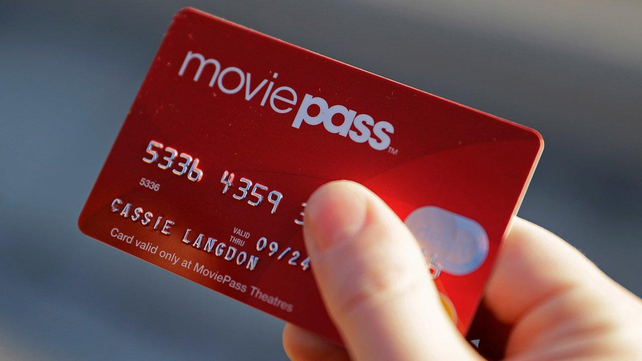 A woman holds her MoviePass card outside an Indianapolis movie theater.