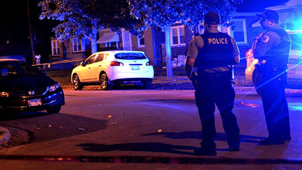 Police investigate a shooting about 10:30 p.m. Friday, August 10, 2018 in the 200 block of East 123rd St. in Chicago.