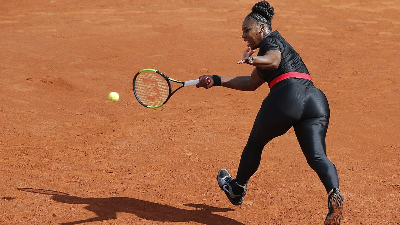 FILE - In this May 29, 2018 photo, Serena Williams returns a shot at the French Open. She will no longer be allowed to wear her sleek, figure-hugging catsuit at the French Open.