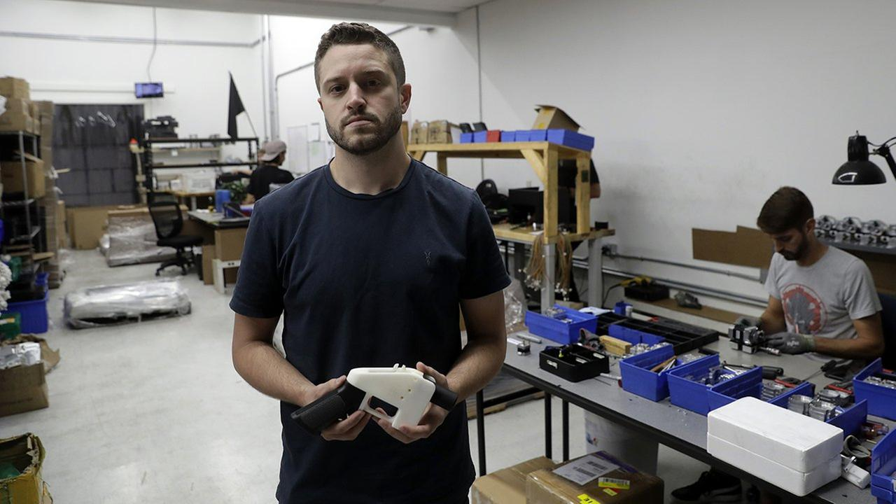 Cody Wilson, with Defense Distributed, holds a 3D-printed gun called the Liberator at his shop, Wednesday, Aug. 1, 2018, in Austin, Texas.