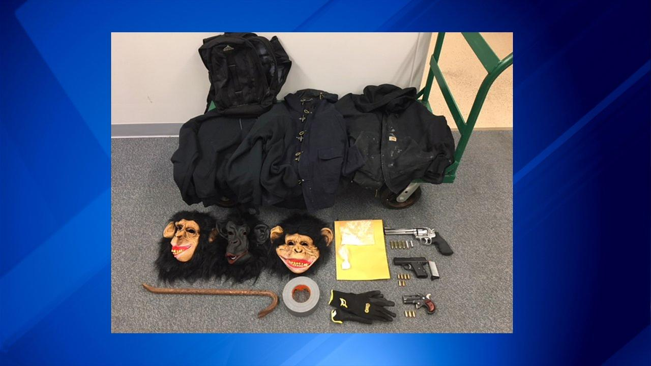 Three Wisconsin men were found Wednesday morning near north suburban Antioch with guns, drugs and monkey masks inside their vehicle, according to authorities.
