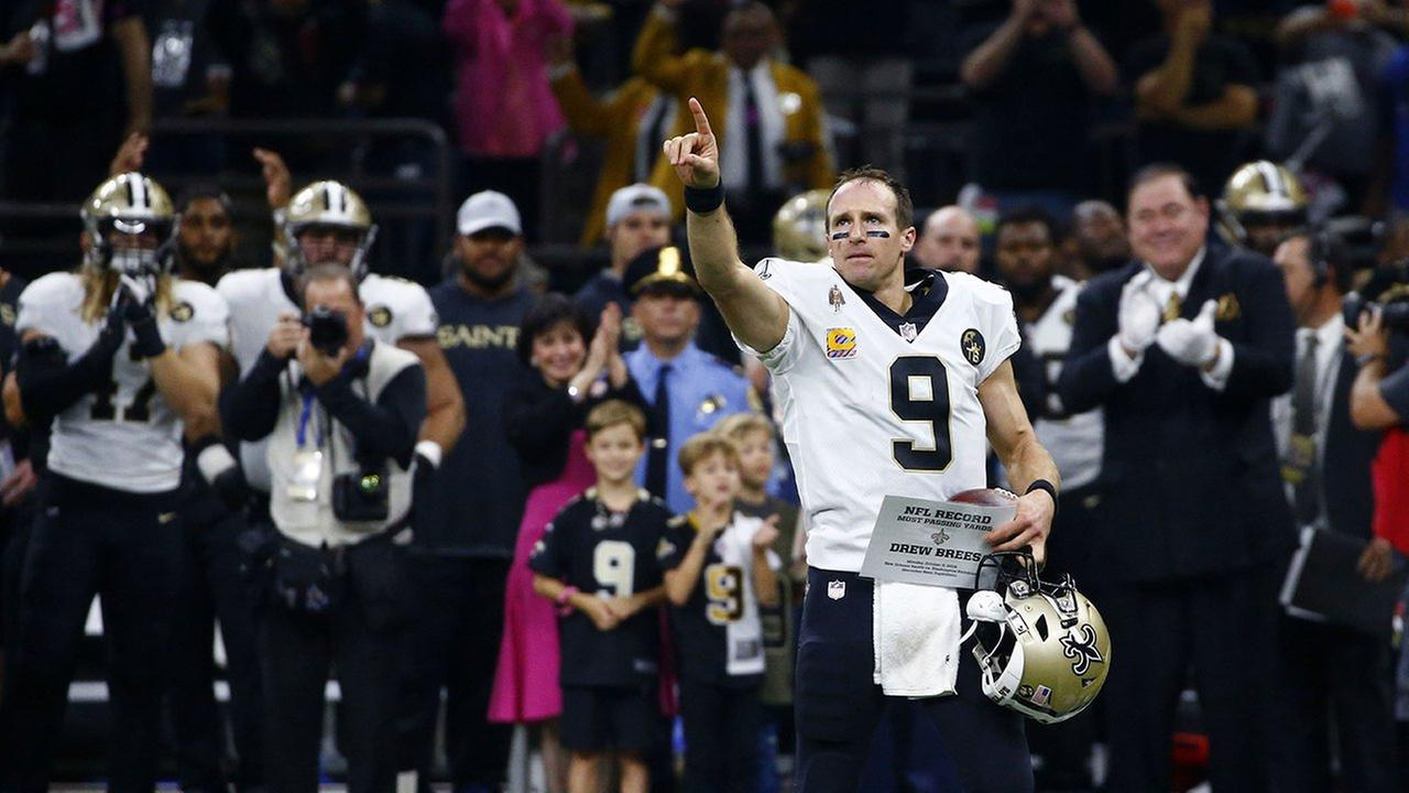 New Orleans Saints quarterback Drew Brees responds to the crowd after breaking the NFL all-time passing yards record in an NFL football game against the Washington Redskins.