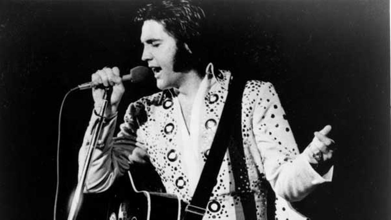 Elvis Presley is shown performing in this undated photo at an unknown location.