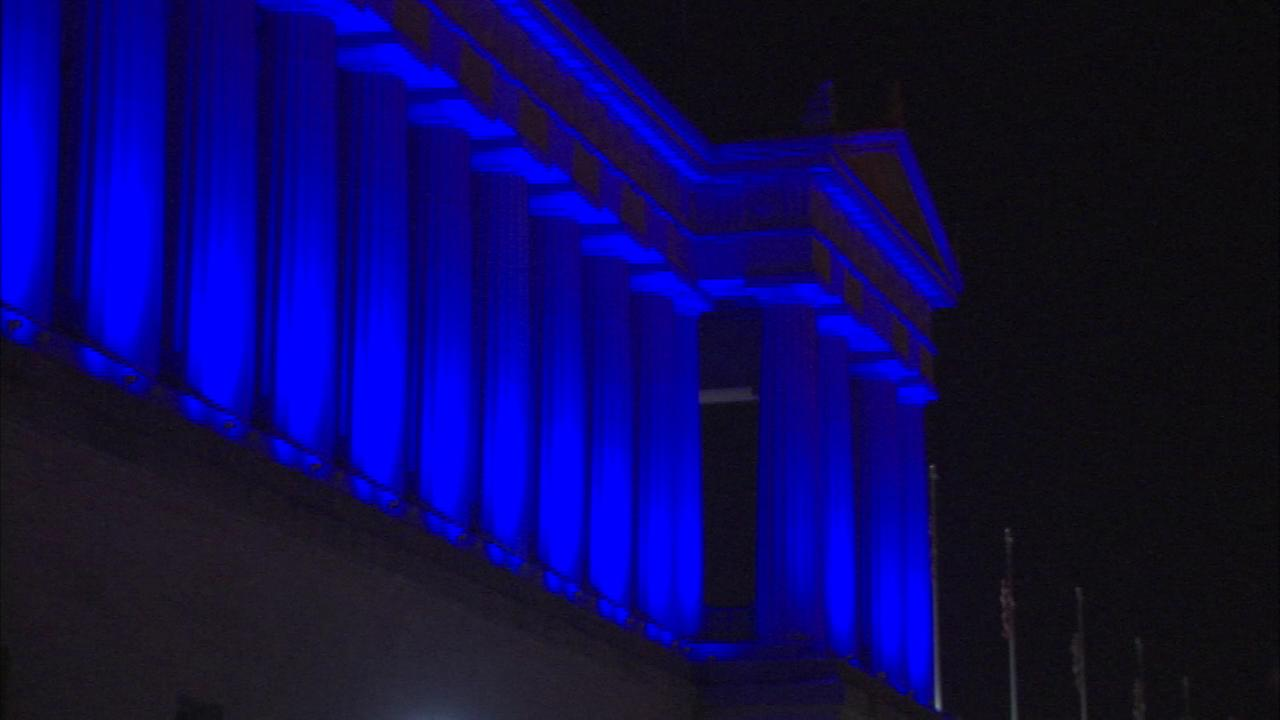 Chicago buildings glow blue for peace