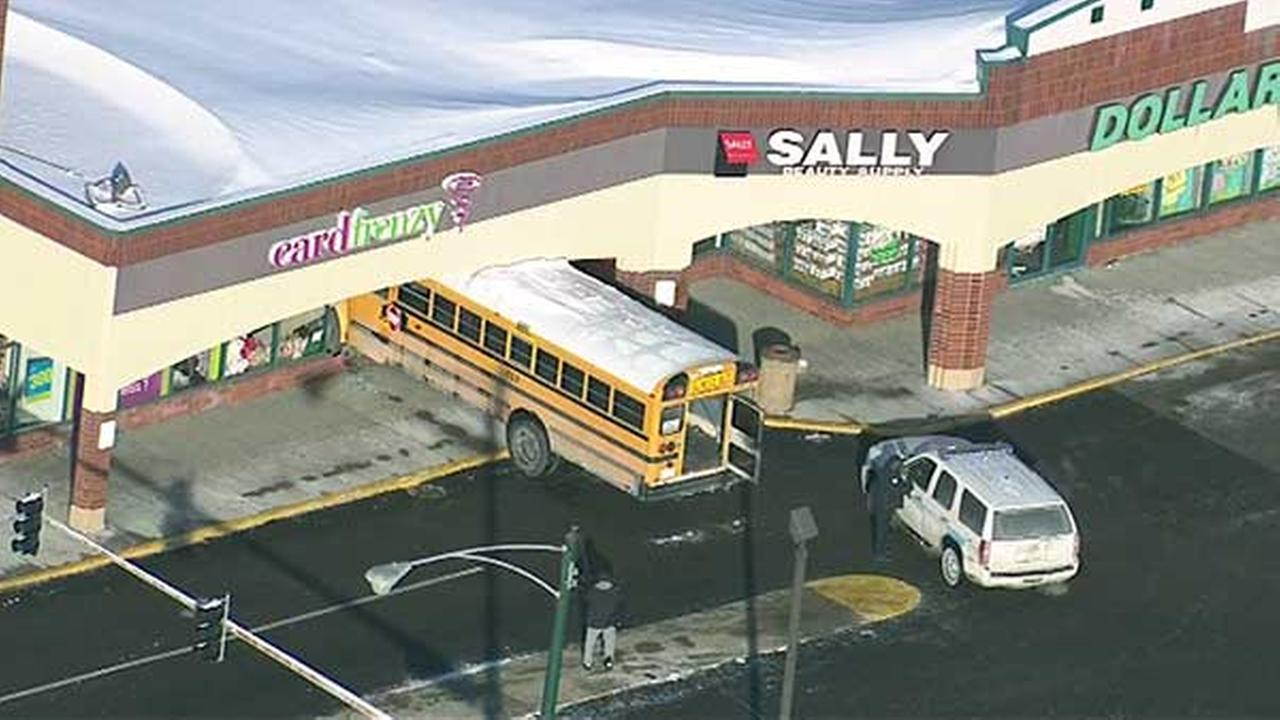 Empty school bus crashes into Card Frenzy store