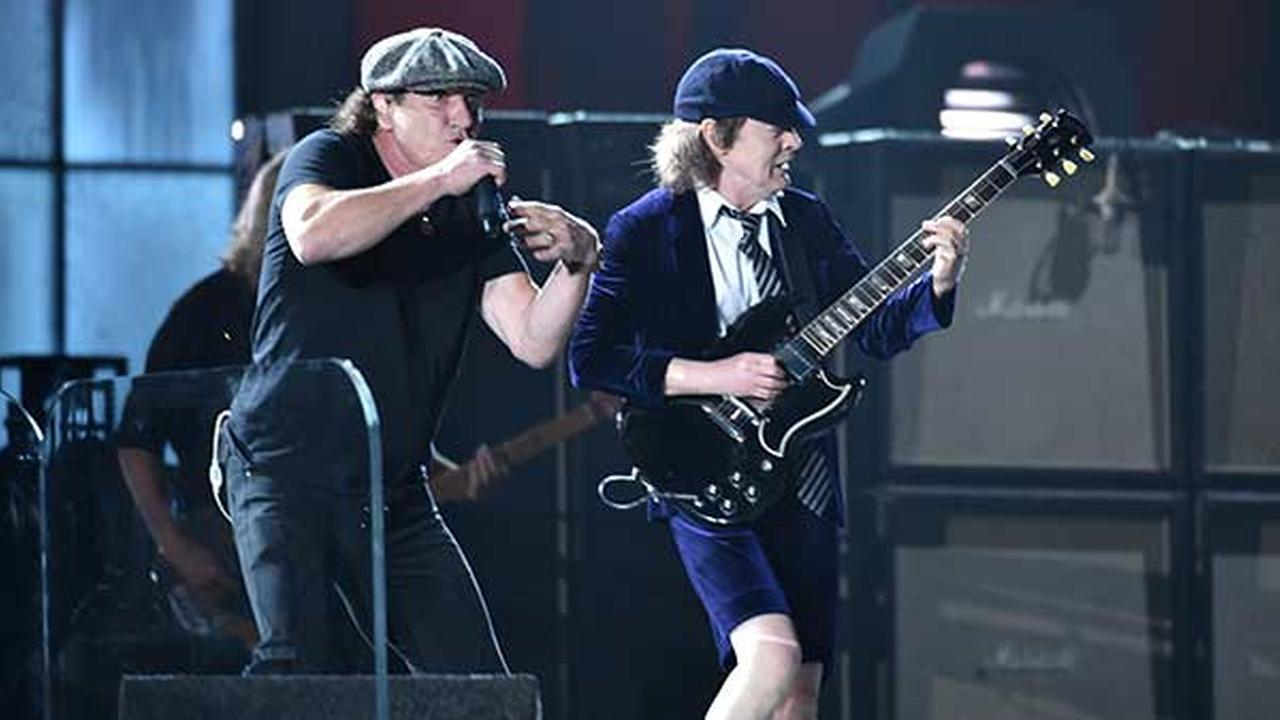 Brian Johnson, left, and Angus Young of AC/DC perform at the 57th annual Grammy Awards