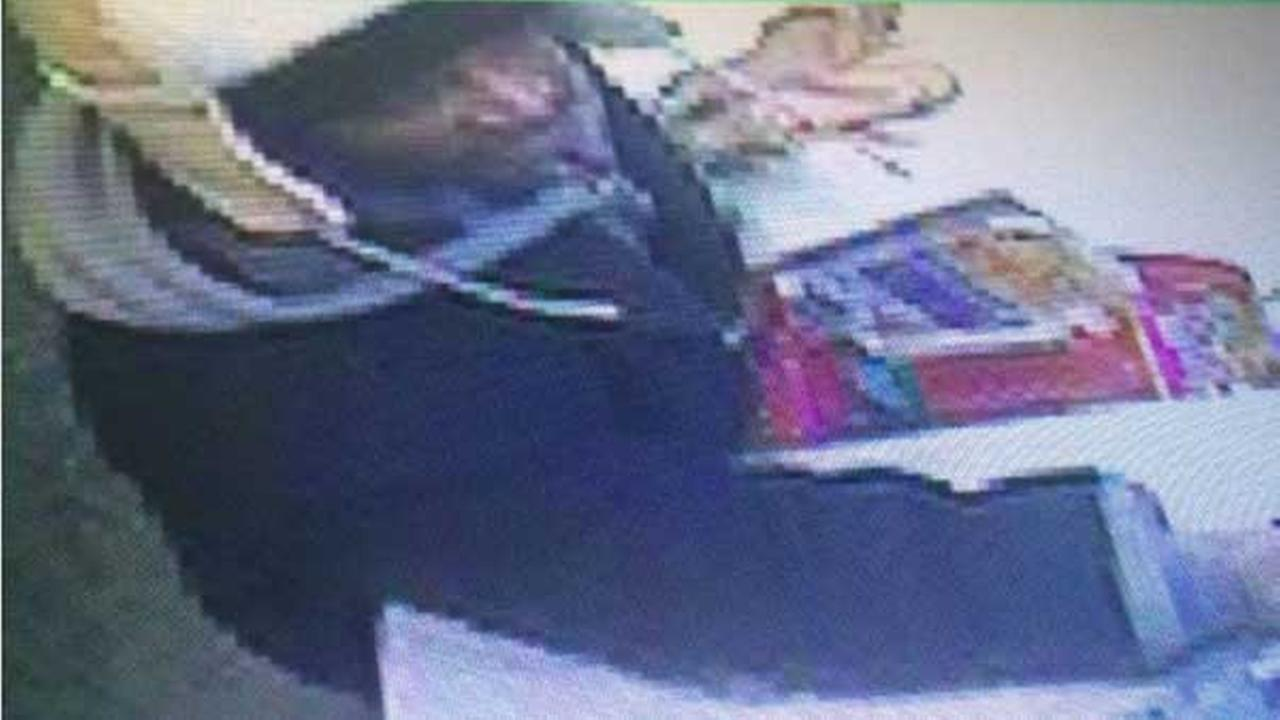A surveillance photo of the man suspected of robbing a business at gunpoint in the 2800-block of North Broadway Avenue.