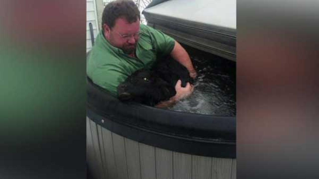 Ind. farmer jumps in hot tub with calf he saved from snow