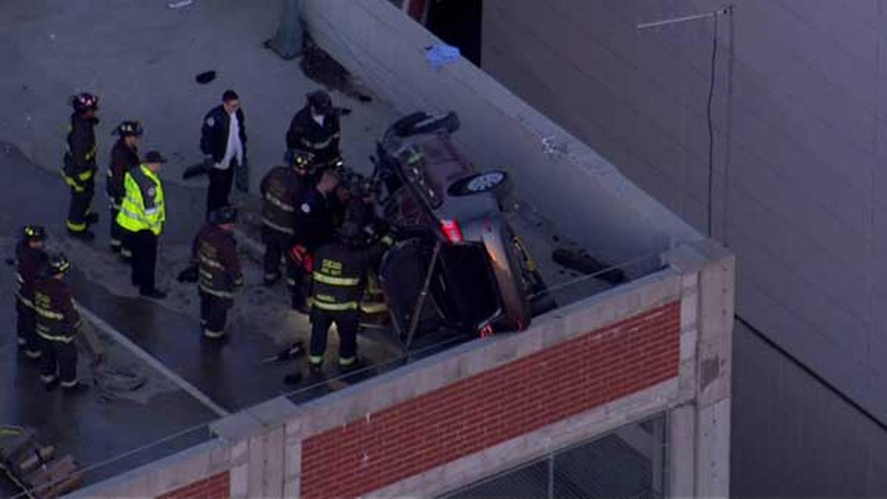 Driver injured after car flips near edge of Rogers Park parking garage