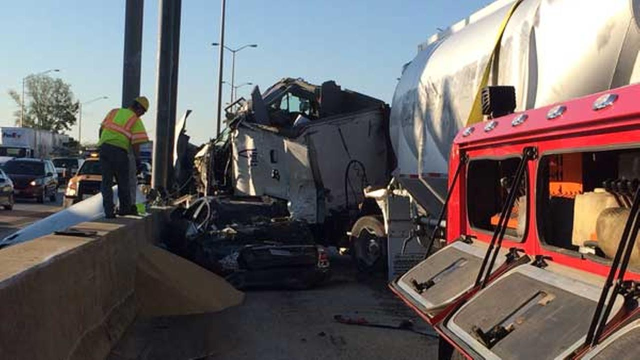A car was wedged between a tanker and a concrete divider after a rollover crash on the southbound Tri-State Tollway near Half Day Road.