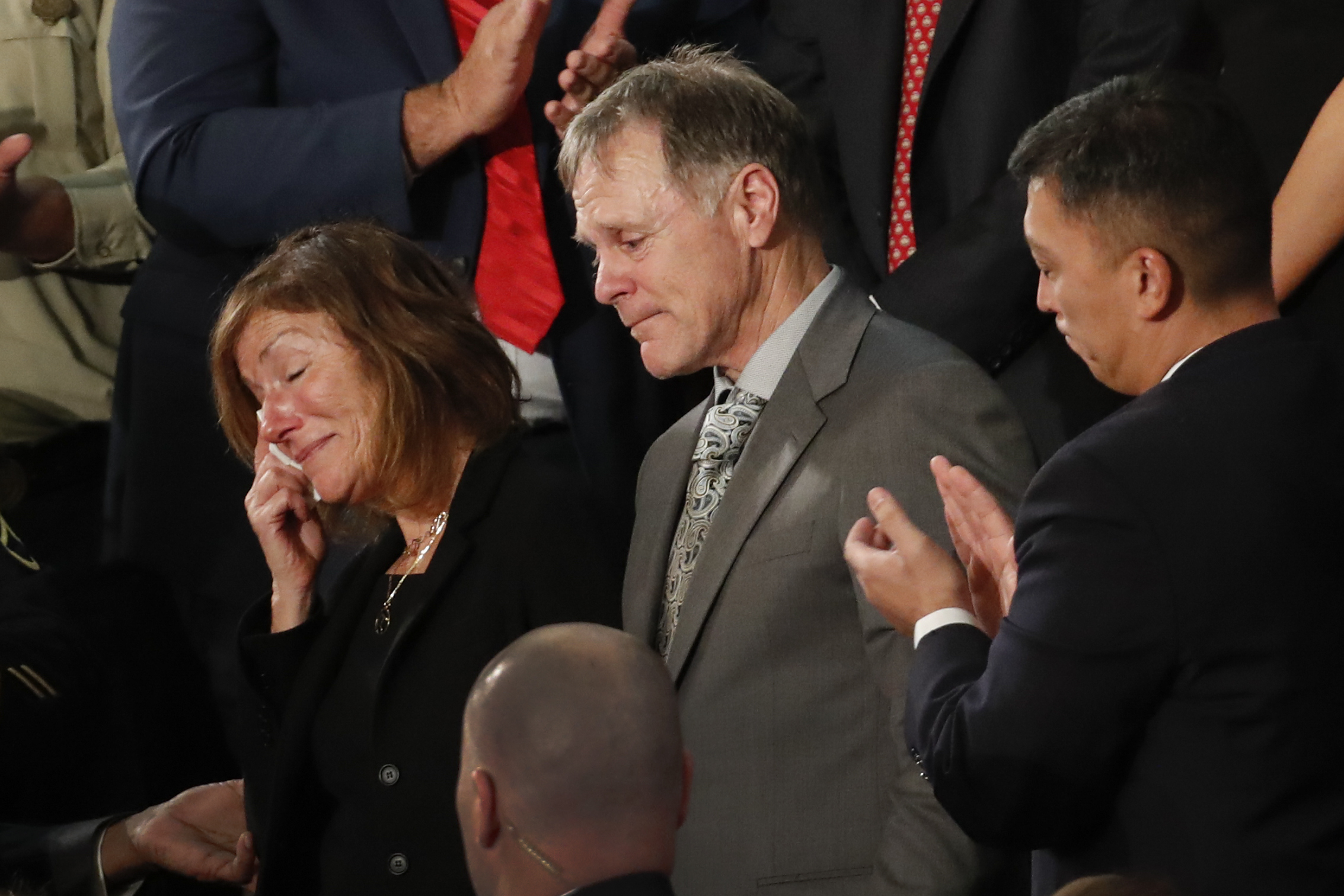 The teary-eyed parents of Otto Warmbier, the American student who died days after being freed from imprisonment in North Korea, react to a standing ovation during the 2018 State of the Union address.