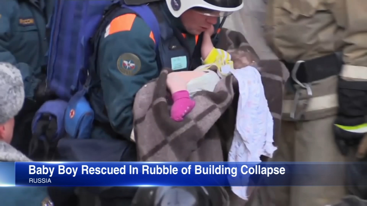 Russian rescuers pulled an infant boy alive from the rubble of an apartment building, some 35 hours after a collapse that killed at least seven people and left dozens missing.