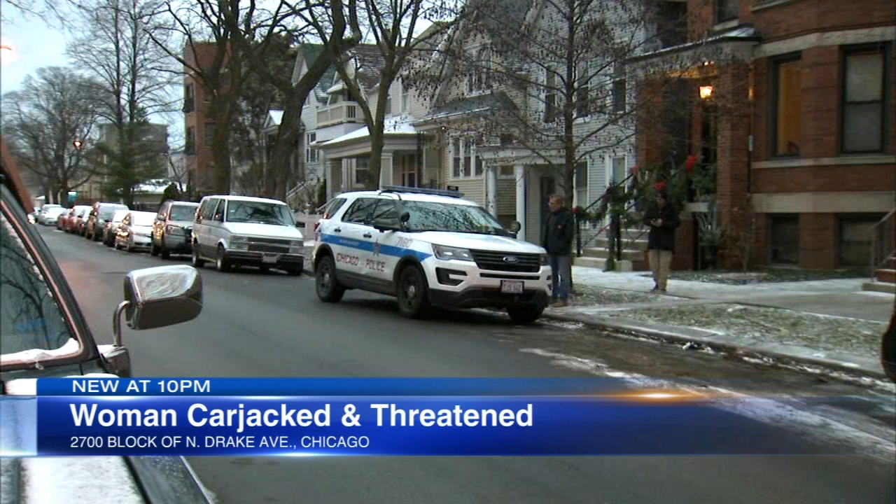 Chicago police are searching the person who carjacked a woman in her own garage and threatened to sexually assault her.
