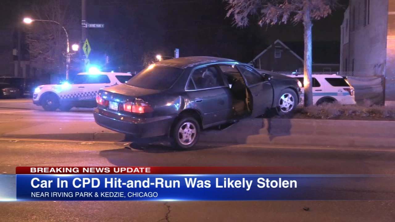 Chicago police say the car involved in a hit-and-run crash that hurt two officers may have been stolen.