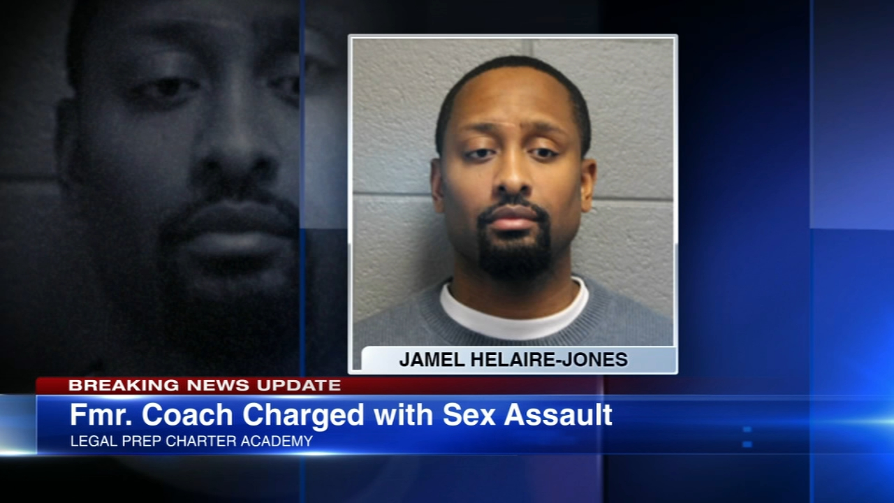 A former basketball coach at a charter school on the West Side is charged with sexually assaulting two students, prosecutors said Wednesday.