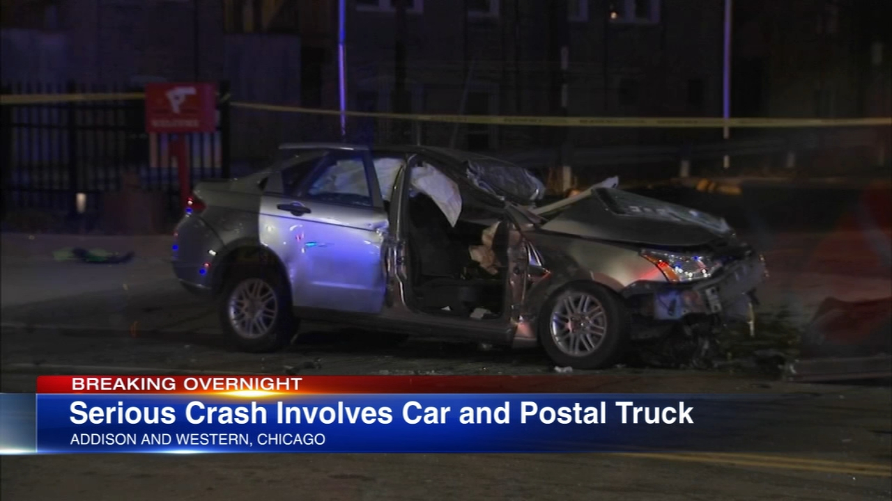A car struck a USPS semi truck after running a red light early Saturday.