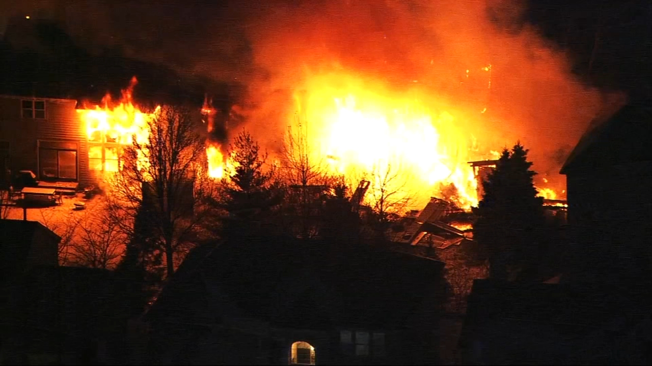A fire spread from one home to two neighboring houses in the north suburbs Wednesday morning.