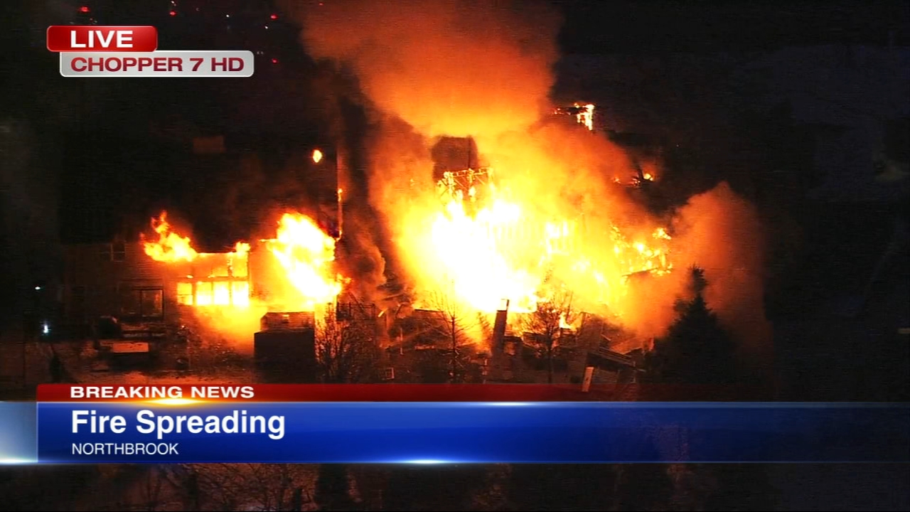 A fire spread from one home to another in the north suburbs Wednesday morning.