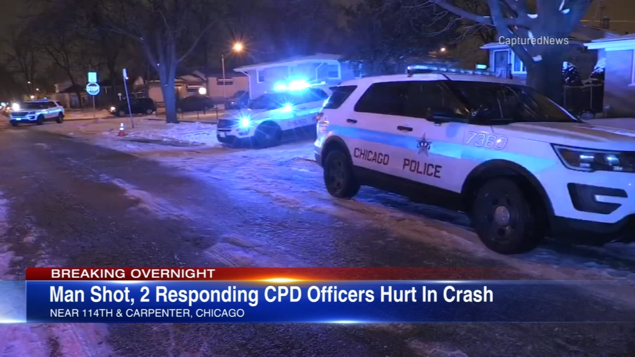 Two Chicago police officers were injured in a crash while responding to a shooting that left a man wounded in Chicago?s Morgan park neighborhood Wednesday morning.