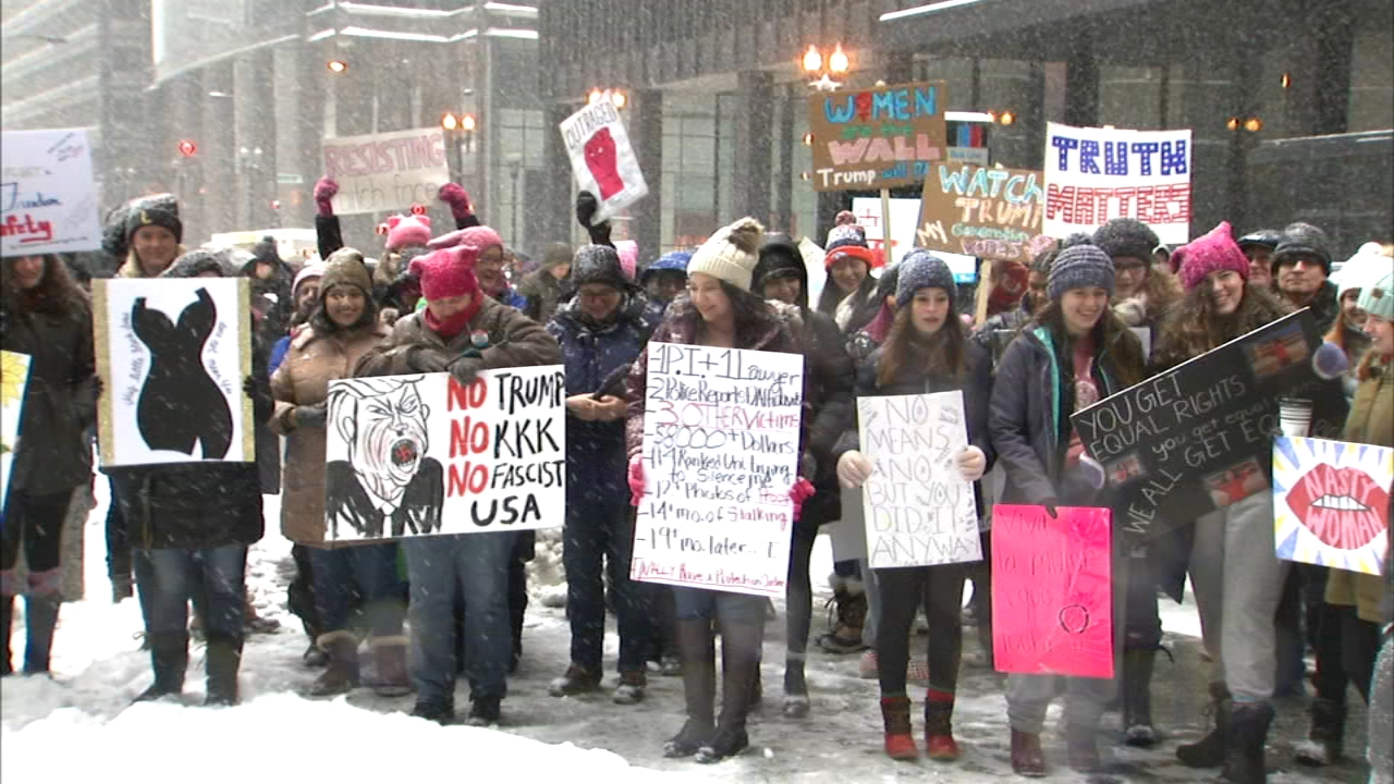 A group gathered in Federal Plaza on Saturday in solidarity with Womens Marches across the U.S.