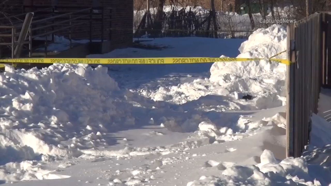 Two girls became trapped while playing in a snowbank Sunday afternoon.