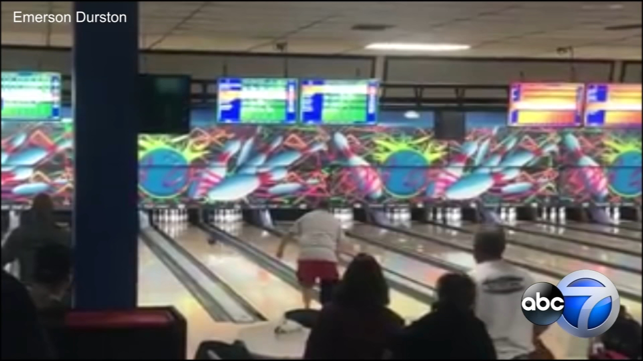 Dozens gathered behind double amputee Ricky Rader as he approached the lane, just one strike away from a perfect game.