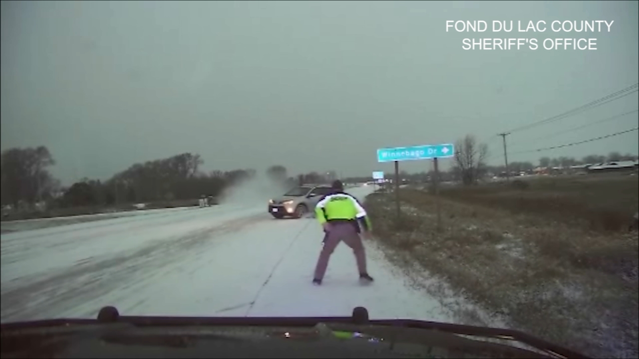 Dramatic dashcam video shows a sheriffs deputy run to safety just in time as an out-of-control vehicle careened toward him on snow-covered highway in Wisconsin.