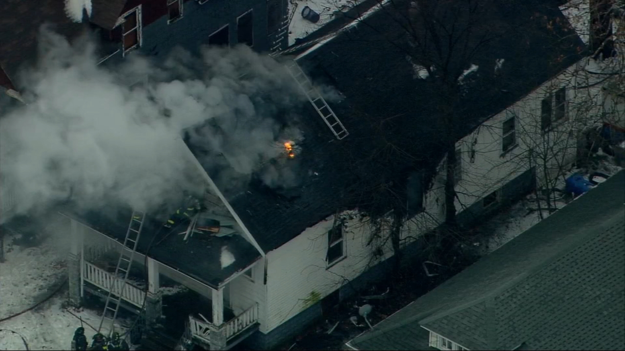 Chicago firefighters worked to contain a blaze at a home in Chicagos West Pullman neighborhood.