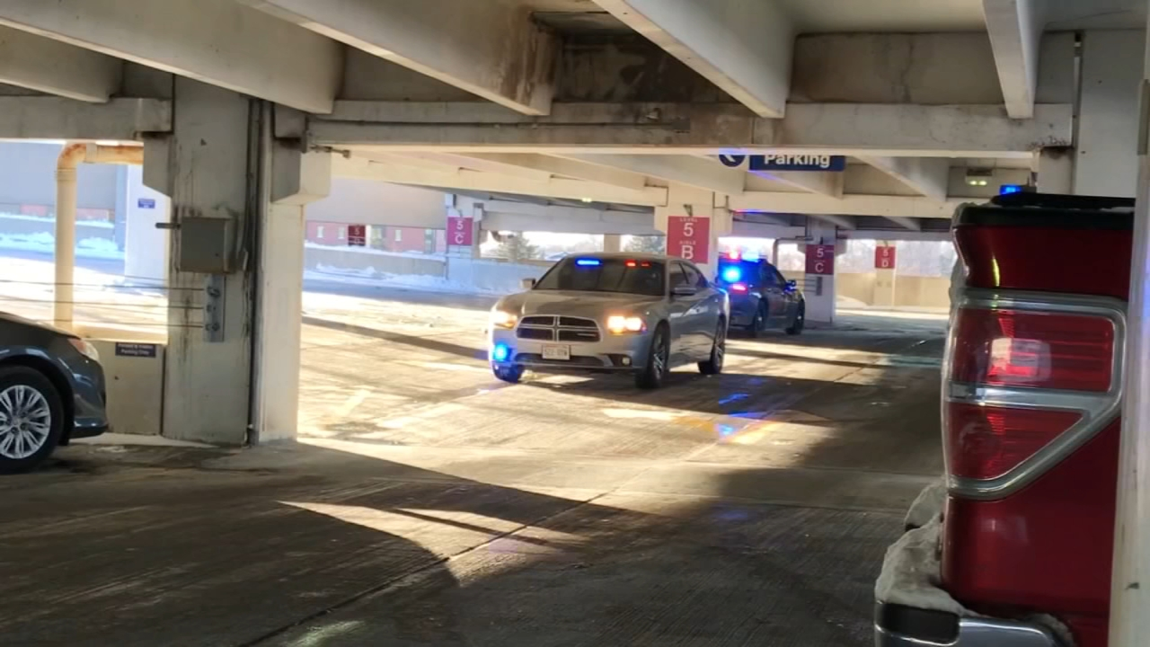 An unidentified 33-year-old woman was found frozen and lodged underneath a car on the 6th floor of the hospital garage.