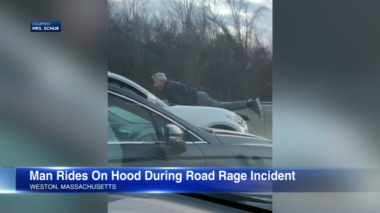 Two drivers have been charged after a road rage incident where a man ended up on the hood of an SUV driving on the Mass Pike. It ended when a man with a gun forced the driver out o