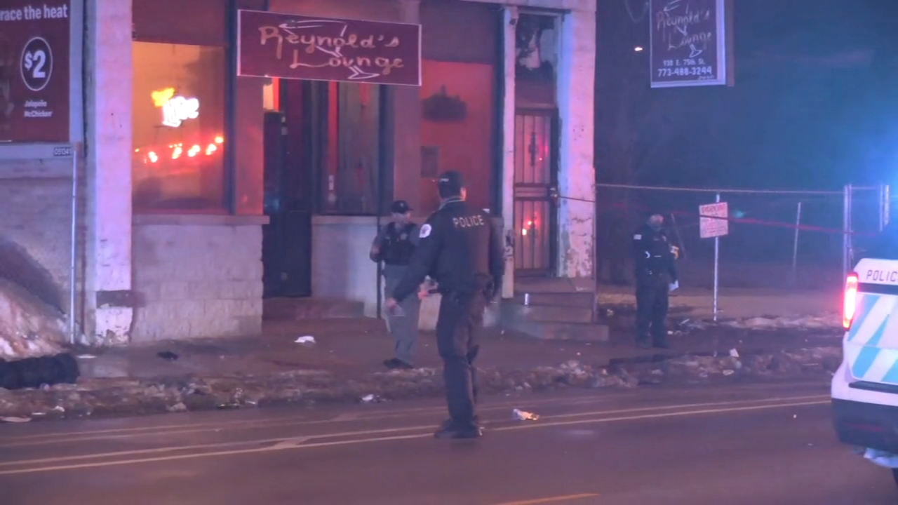 Chicago police are looking for the gunman who killed two people outside a bar on the South Side.