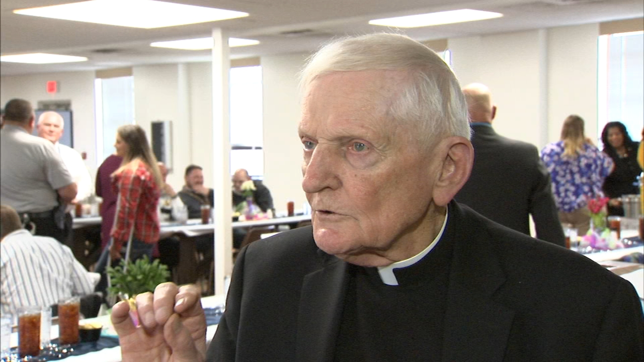 Father John Waugh, the chaplain at Sheridan Correctional Center, was honored in a surprise ceremony Tuesday.