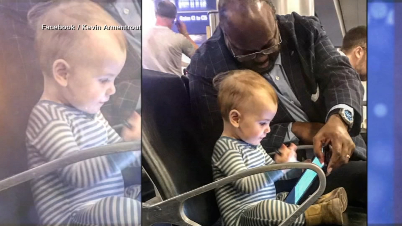 A photo of a businessman and a toddler bonding in an airport is going viral.