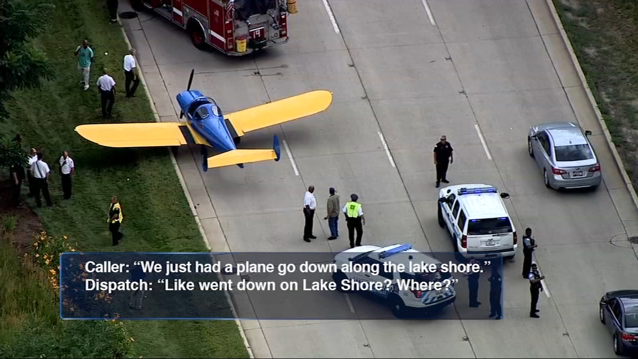 The 911 calls made by shocked drivers as they watched a small plane land on Lake Shore Drive at the end of July have just been released.