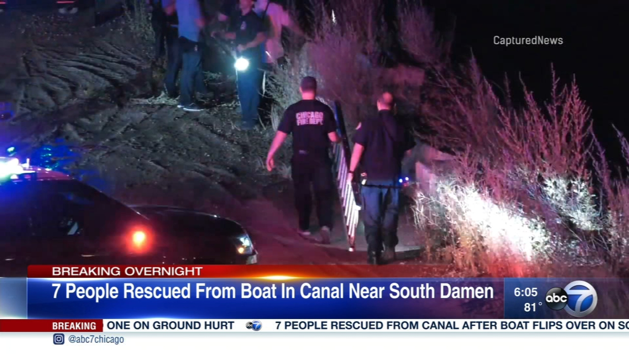 Seven people were rescued from a capsized boat on the South Side Saturday.