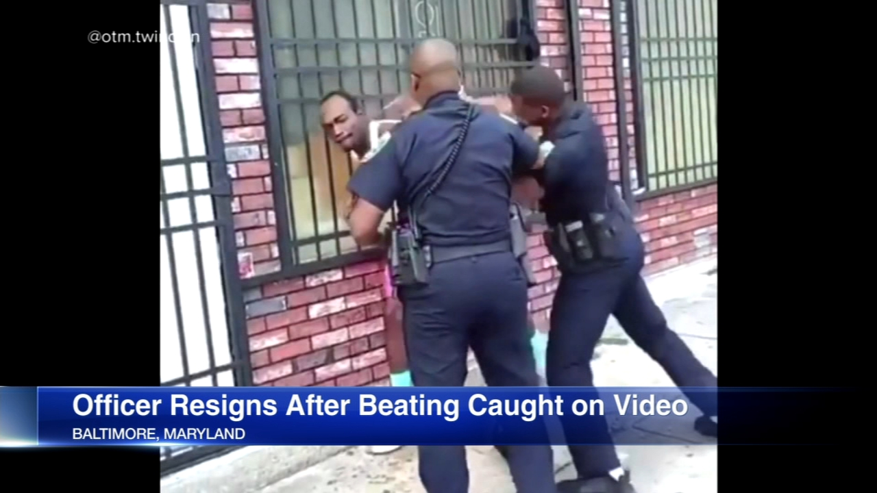 A Baltimore Police officer who was seen punching a man in a video has resigned and may face assault charges.