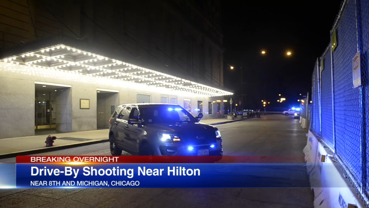 A man was wounded in a drive-by shooting outside the Hilton Hotel in the South Loop Monday morning.