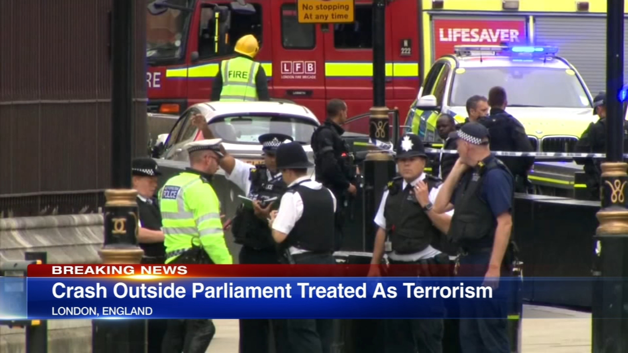 A car crashed into pedestrians and cyclists near the Houses of Parliament in London Tuesday and police arrested a man on suspicion of terrorism, heightening tensions in a city that