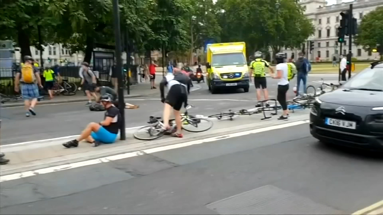 Police flooded central London streets and cordoned off the citys government district Tuesday, after a speeding car plowed into cyclists and crashed outside Parliament.