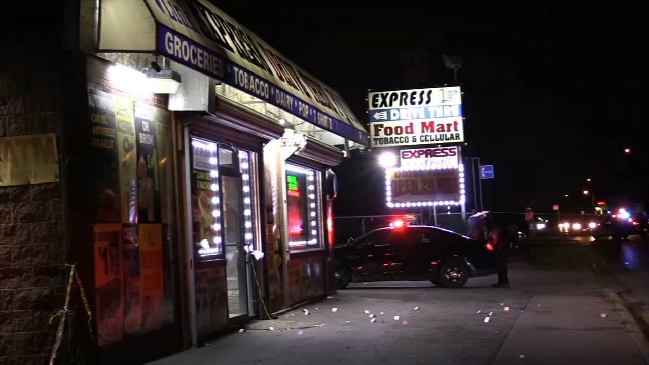 Two people were shot and killed at a convenience store in south suburban Harvey late Tuesday night. Police said their killers are on the run.